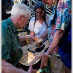 Bruce Cockburn signs SEVA guitar - Kate Wolf Festival - photo - Kim Sallaway